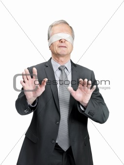 Male entrepreneur wearing blindfold and searching somebody