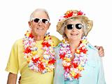 Old couple standing together and wearing garland