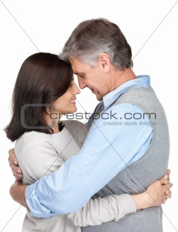 Couple hugging and looking at each other
