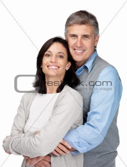 Portrait of handsome mature man hugging his wife