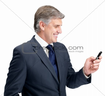 Happy mature businessman texting form his mobile phone