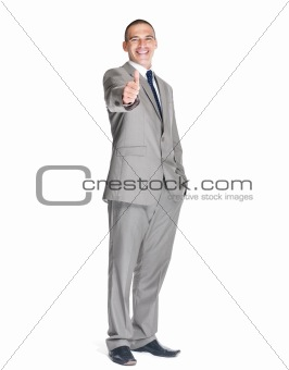 Portrait of a confident young male business executive showing thumbs up sign