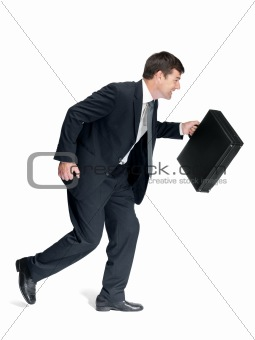 Young male entrepreneur hurrying to office