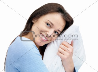Pretty young woman holding a pillow
