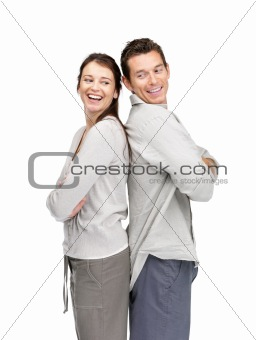 Smiling young couple standing back to back
