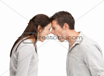 Portrait of an angry couple shouting each other head to head