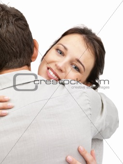 Cute young woman hugging to a young man