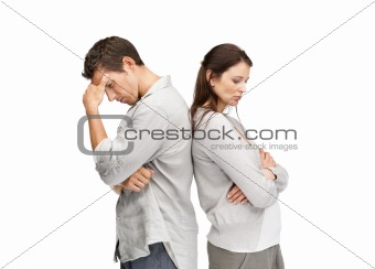 Young couple standing back to back having relationship difficulties