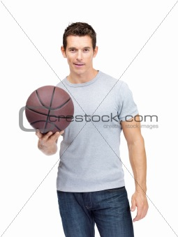 Handsome young male holding a basket ball