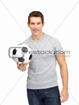 Portrait of a happy young male holding a soccer ball