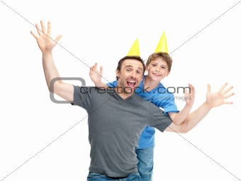 Excited father and son wearing birthday cap