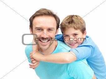 Portrait of a happy young man giving his son piggyback ride