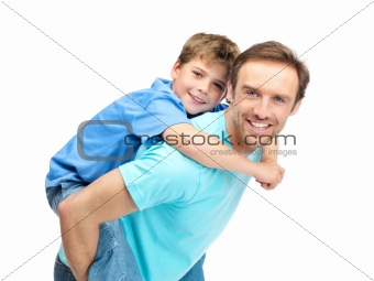 Portrait of a handsome father giving son piggyback ride