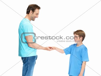 Happy man and his son holding hands