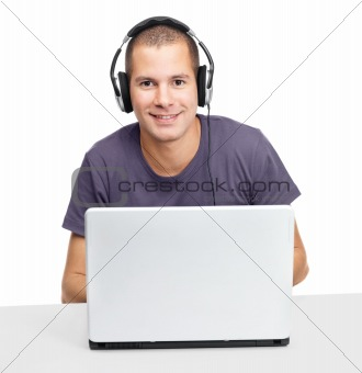 Handsome young man using laptop wearing headphone