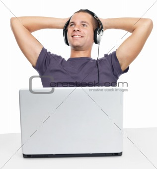 Portrait of a happy young guy listening to music