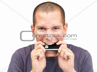 Portrait of a frustated man biting the mobile phone