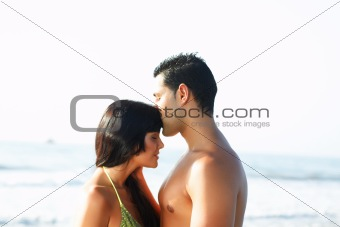 loving couple on the edge of  the beach