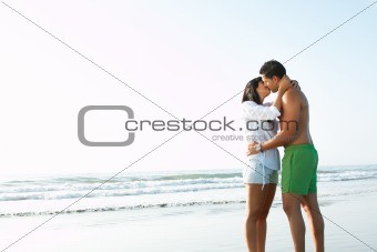 adorable  couple in love kissing and embracing each other