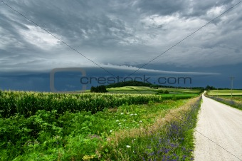 Storm Clouds Over a Country Road