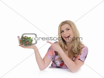 Casual woman eating healthy green vegetable salad. isolated