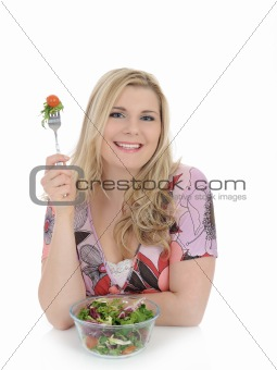 beautiful woman eating green vegetable salad. isolated on white