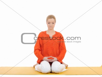 series or yoga photos. young woman in virasana pose
