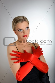 Portrait of sexy fashion woman with red lips and gloves looking