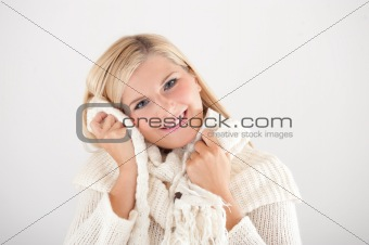 pretty winter girl in white hat smiling