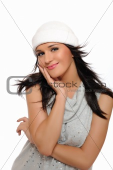 Expressions. Beautiful winter girl in a hat smiling. isolated