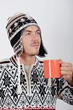 handsome winter man drinking hot tea