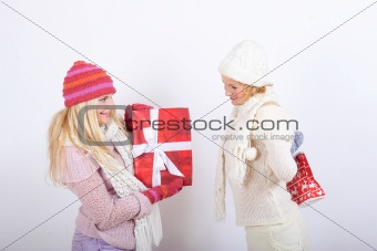 Two pretty winter girls friends making presents