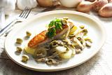 baked salmon on champignons, onion and olives