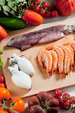 still life of raw seafood and vegetables