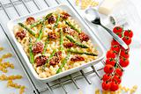 pasta baked with dried tomatoes, asparagus and pecorino cheese