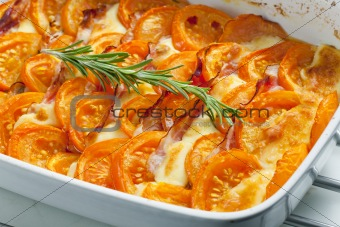 tomatoes baked with mozzarella cheese and pancetta