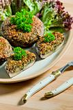 baked champignons filled with peanuts mixture