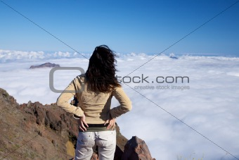 back woman over fog ocean
