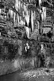 cascade of melting icicles on a cliff face