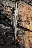 dripping frozen icicles on a cliff face
