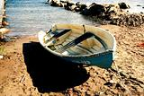Boat on sandy beach at sunny day