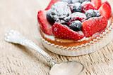 Fruit tart with spoon