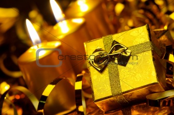 Gold christmas candles and gold gift boxes