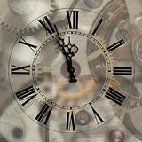 Old hours with figured arrows on mechanism blur background