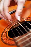 Closeup of a guitarist playing