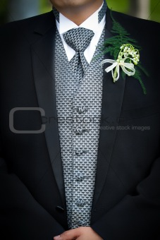 Groom with flower on chest