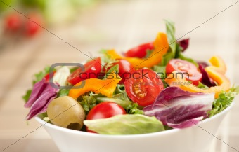green salad in a white bowl