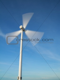 windy day with motion wind turbine.