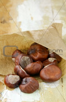 fresh chestnuts in brown paper bags
