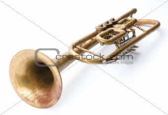 Old vintage trumpet isolated over white